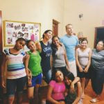 PourOut team members Alisa and Jesse having some silly fun with the girls from La Villa's ministry.